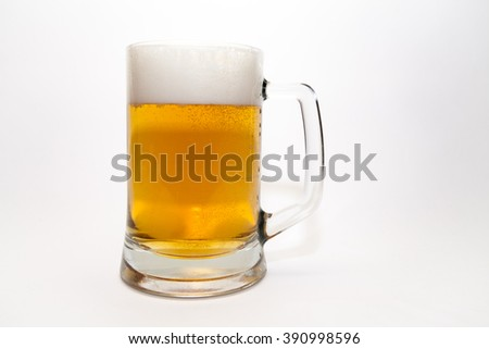 A mug of beer on a white background