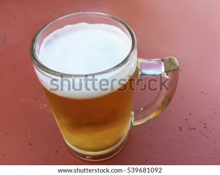 A mug of beer on iron table in the restaurant