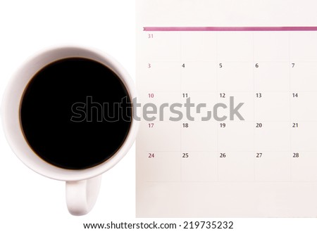 A mug of coffee and table day planner - stock photo