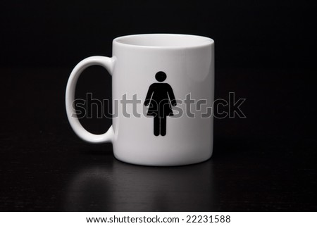 A mug with a female on it isolated on a black background.