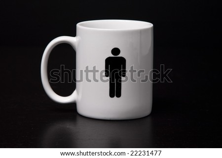 A mug with a male on it isolated on a black background. - stock photo
