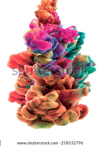 A multicolored ink drop swirling in water, creates an organic form of silky structure, with warm color tones.   - stock photo