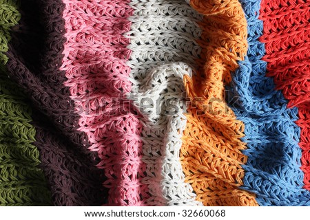 a multicolored knitted security blanket - stock photo