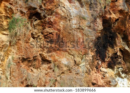 A multicolred rock canyon wall along the banks of the Nile in Uganda, Africa - stock photo