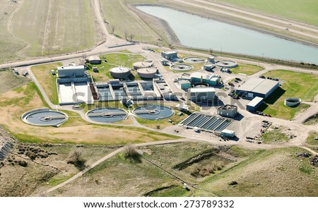 A municipal sewage treatment facility for a city of 50,000 people. - stock photo