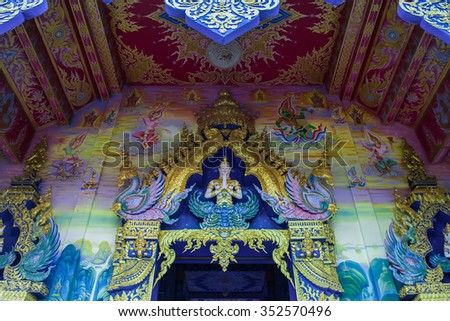 A mural painting in native thai fine art on the wall and ceiling of Buddhist temple Chiang Rai,Thailand - stock photo