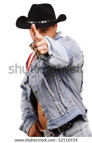 A muscular man in a cowboy hat shooting from a finger. Isolated on white. - stock photo
