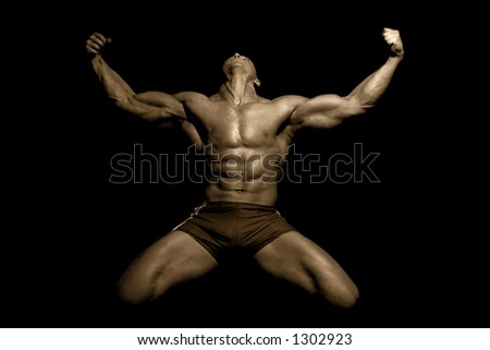 a muscular man posing artistic - stock photo