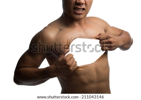 A muscular man pulling his chest skin away showing blank space - stock photo
