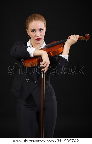 A musician posing with violin - stock photo