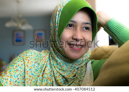 A muslim woman relaxing at her home  - stock photo