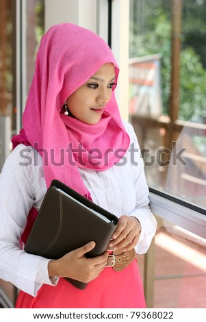 A muslim woman with diary book - stock photo