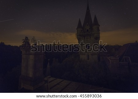 A mysterious old abandoned castle in Belgium at night (Miranda / Noisy Castle) - stock photo