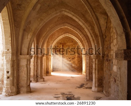 a mystical view of the interior of a ruined church - stock photo