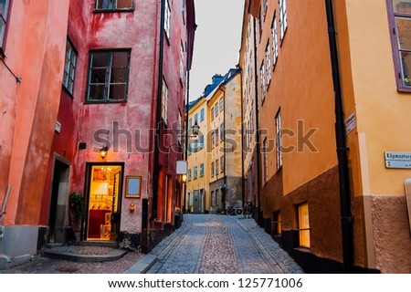 A Narrow Cobbled Street and Colourful Buildings in Stockholm Old Town - stock photo