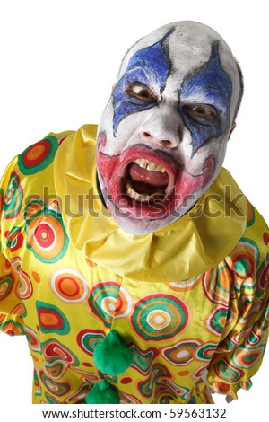 A nasty evil clown, angry and looking mean. Harsh lighting from below.