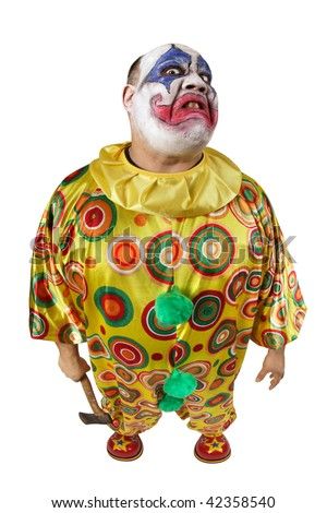A nasty evil clown holding an axe, angry and looking mean. Fisheye lens with focus on the face. - stock photo