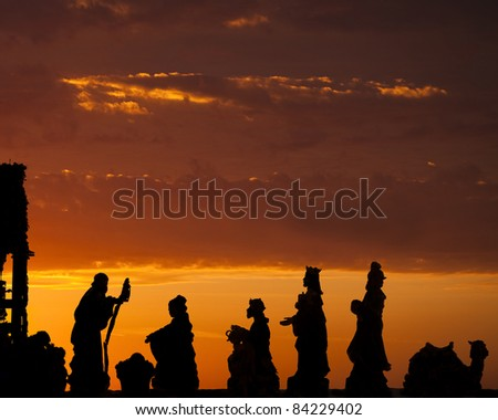A nativity scene with wise men set against a dramatic sunrise - stock photo