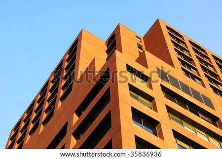 A neat high rise office building under the blue sky in downtown edmonton, alberta, canada - stock photo