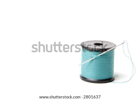 A needle and thread for sewing and repair - stock photo