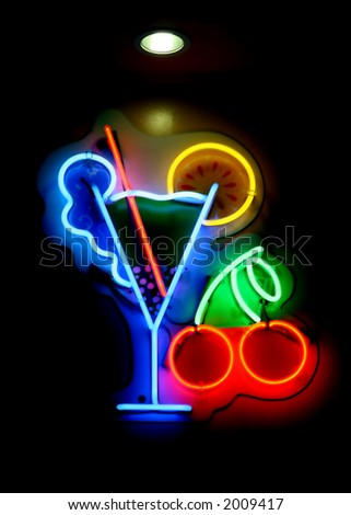A neon cocktail sign at a bar - stock photo