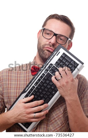 A nerd loves his keyboard - stock photo