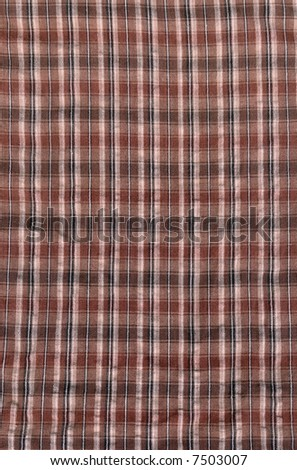 A neutral brown plaid cloth, suitable for a background texture. - stock photo