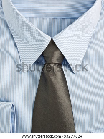 A new blue shirt with necktie, studio shot - stock photo