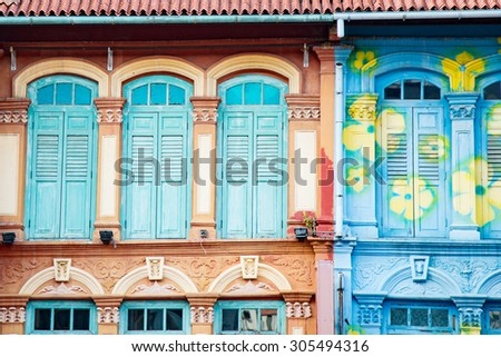 A new colorful neighborhood estate among domestic garden in Singapore - stock photo