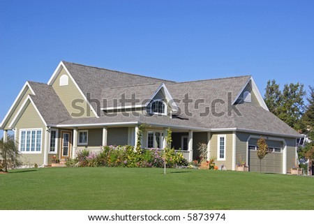 A new executive home with landscaped grounds. - stock photo