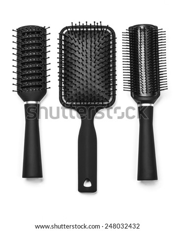 a new hair brushes in detail isolated on white background - stock photo