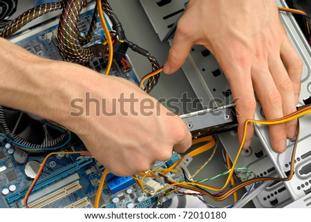 A new hard drive is being inserted into the computer case - stock photo
