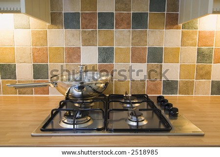 A new hob with frying pan - stock photo