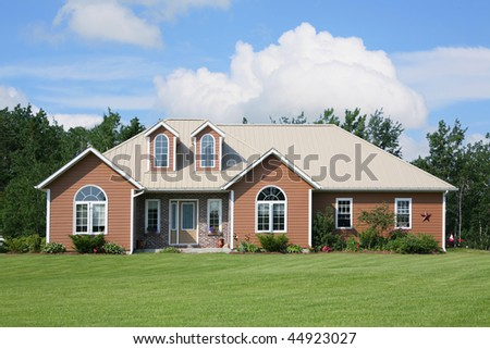 A new home in a rural area, recently constructed. - stock photo