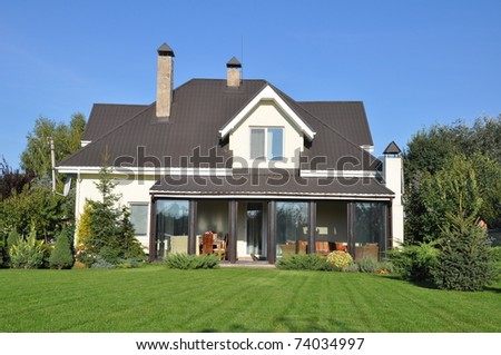a new house with its garden - stock photo