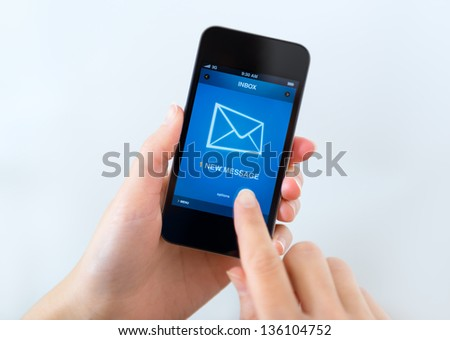 A new message received on mobile phone. - stock photo