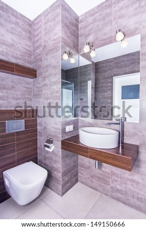 A new modern bathroom with concrete walls in luxury apartment in Cracow, Poland - stock photo