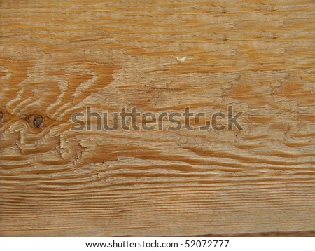 A new natural pine wood fence yellow / brown background - stock photo