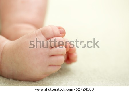 a newborn baby closeup feet. shallow DOF, focus on toes - stock photo