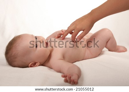 A newborn baby grasps his mother's hand