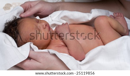 A newborn baby in a cloth after bath - stock photo