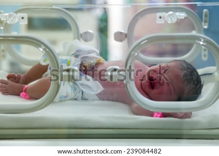 A newborn in nursery after childbirth - stock photo
