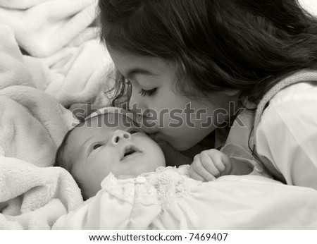 A newborn little girl. Family, love, caring. - stock photo