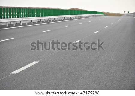 A newly built motorway with no traffic - stock photo
