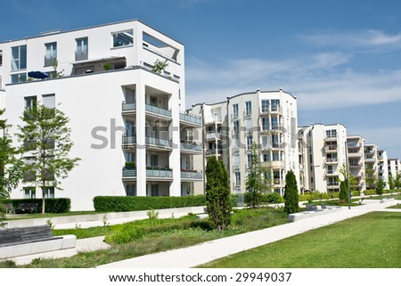A newly completed housing estate in a summer setting. - stock photo