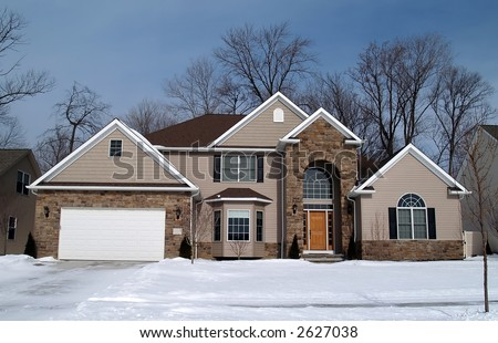 A newly constructed home in a suburban development - stock photo