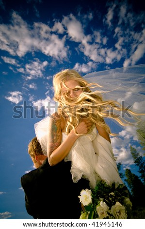 A newlywed couple right after the ceremony. - stock photo