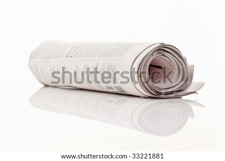 A newspaper lies on a white background