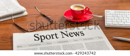 A newspaper on a wooden desk - Sport News - stock photo
