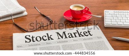 A newspaper on a wooden desk - Stock Market - stock photo